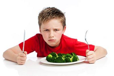 boy hating broccoli