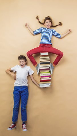 children playing with group of books 270