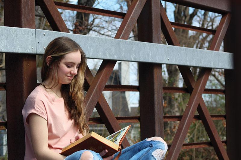 Mira Dover reading a book.
